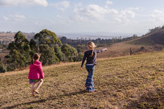 Young Girls Exploring Walking Wilderness Reserve Stock Photo