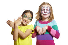 Young girls with face painting of cat and butterfly Stock Photos