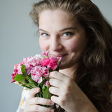 Young girls with flovers. Beautiful smile and eyes Royalty Free Stock Photography