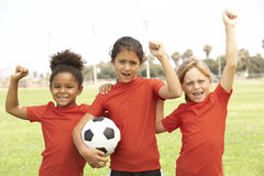 Young Girls In Football Team Celebrating. Holding Soccer Ball Royalty Free Stock Photo