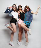 Young girls friends dancing of joy in full length Stock Images