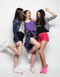 Young girls friends dancing of joy in full length Royalty Free Stock Images