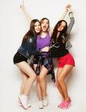 Young girls friends dancing of joy in full length Stock Photo