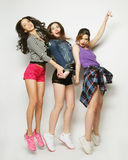 Young girls friends dancing of joy in full length Stock Image