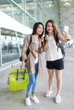 Young girls go travel and taking selfie with mobile phone in Hon Stock Photography
