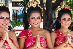 Young girls greet cruise ship passengers. Bali, Indonesia - 18th November 2016. Young girls greet cruise ship passengers. A welcome party meets all ships royalty free stock photos