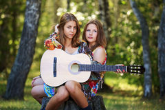 Young girls with guitar on nature Royalty Free Stock Image