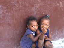 Young girls of Haiti. Haitian children sitting outside of home Stock Photography