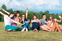 Young girls with hands up Stock Images