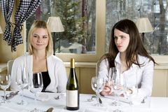 Young girls having dinner in fancy restaurant Royalty Free Stock Photography