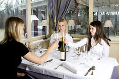 Young girls having dinner in fancy restaurant Stock Photography
