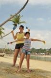 Young Girls Having Fun At The Beach Royalty Free Stock Photos
