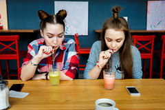 Young girls having fun in a cafe bar Royalty Free Stock Photo