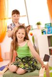 Young girls having fun combing hair Royalty Free Stock Photos