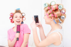 Young girls having fun at home Stock Images