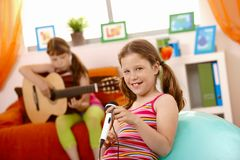 Young girls having fun with music stock photos