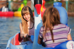 Young girls having fun in a water park Royalty Free Stock Photography