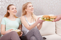 Young girls having lunch at pajama party Stock Image