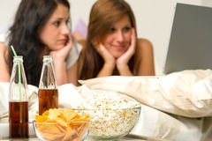 Young girls having slumber party, watching movies Stock Image