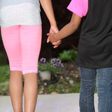 Young Girls Hold Hands For Safety Stock Photos