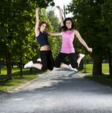 Young girls jogging in the park Stock Photography