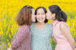 Young girls kissing their mother. Young asian girls kissing their mother outdoor Stock Images