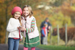 Young Girls Listening To MP3 Player Outdoors Royalty Free Stock Photography