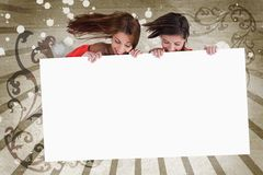 Young girls looking down at white copy space screen Stock Images