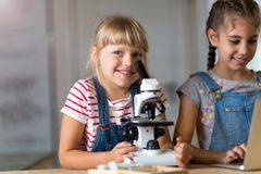 Girls with microscope Royalty Free Stock Photos