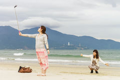 Young girls making selfie at China Beach Danang Stock Image