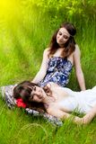 Young girls on the meadow Stock Photos