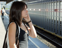 Young girls with a mobile phone. Stock Images