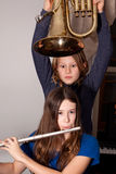 Young girls with musical instruments Royalty Free Stock Images