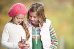 Young Girls Outdoors With MP3 Player Stock Image