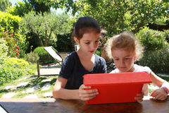 Young girls and a PC tablet Stock Photos
