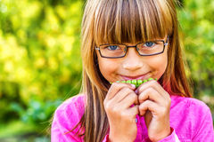 Young girls and peas Stock Photography