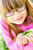 Young girls and peas Stock Photos