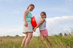 Young girls playing with a ball outdoors Royalty Free Stock Photos