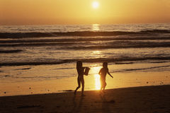 Young girls playing on beach Royalty Free Stock Photography