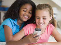Young Girls Playing With A Cellphone. Smiling Stock Images