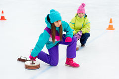 Young girls playing curling stock photos