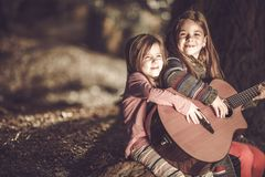 Young Girls Playing Guitar Stock Images