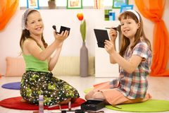 Young girls playing with makeup Stock Image