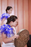Young girls playing snakeskin drums Royalty Free Stock Photography