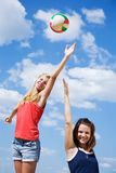 Young girls playing volleyball Royalty Free Stock Image