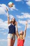 Young girls playing volleyball Royalty Free Stock Photo