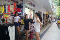 Young girls in the purchase of clothing, in China Stock Photos