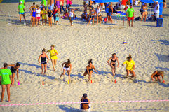 Young girls racing on summer beach. Young girls doing final efforts of a run of the 5th National tournament Young lifeguard on Varna beach on nice summer day Stock Photo