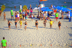 Young girls racing on summer beach Royalty Free Stock Photos