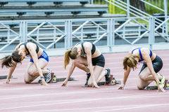 Young girls ready to start. Chelyabinsk, Russia - July 10, 2015: young girls ready to start during Championship of Chelyabinsk on track and field athletics Stock Photos